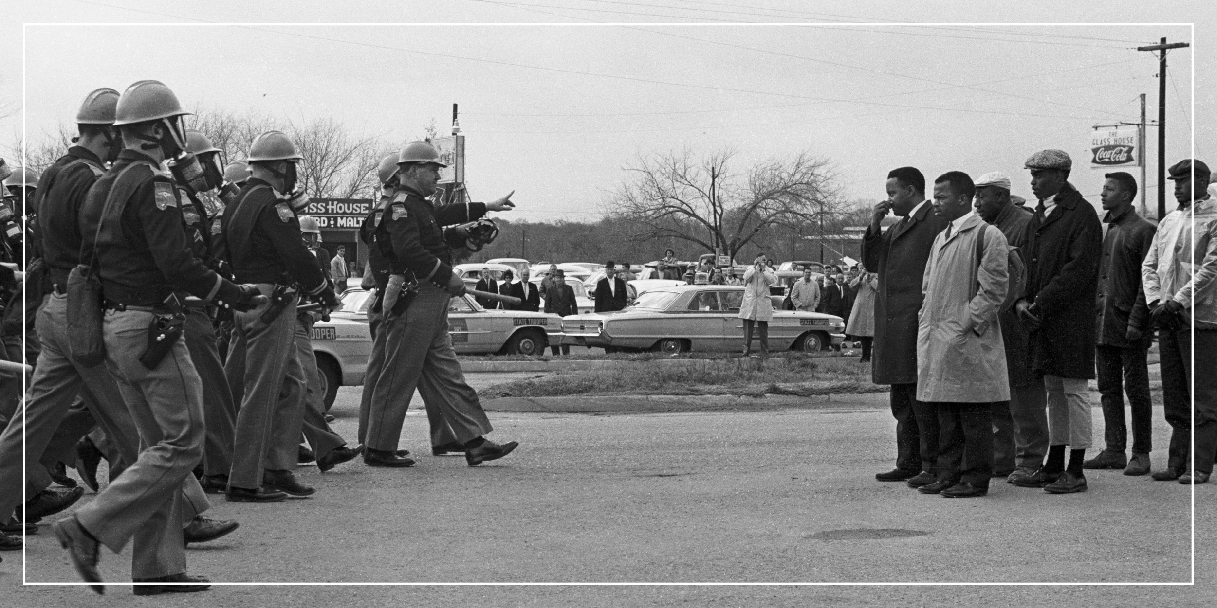 photo of civil rights activists with police in a standoff